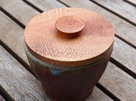 Ceramic bowl with turned macadamia lid