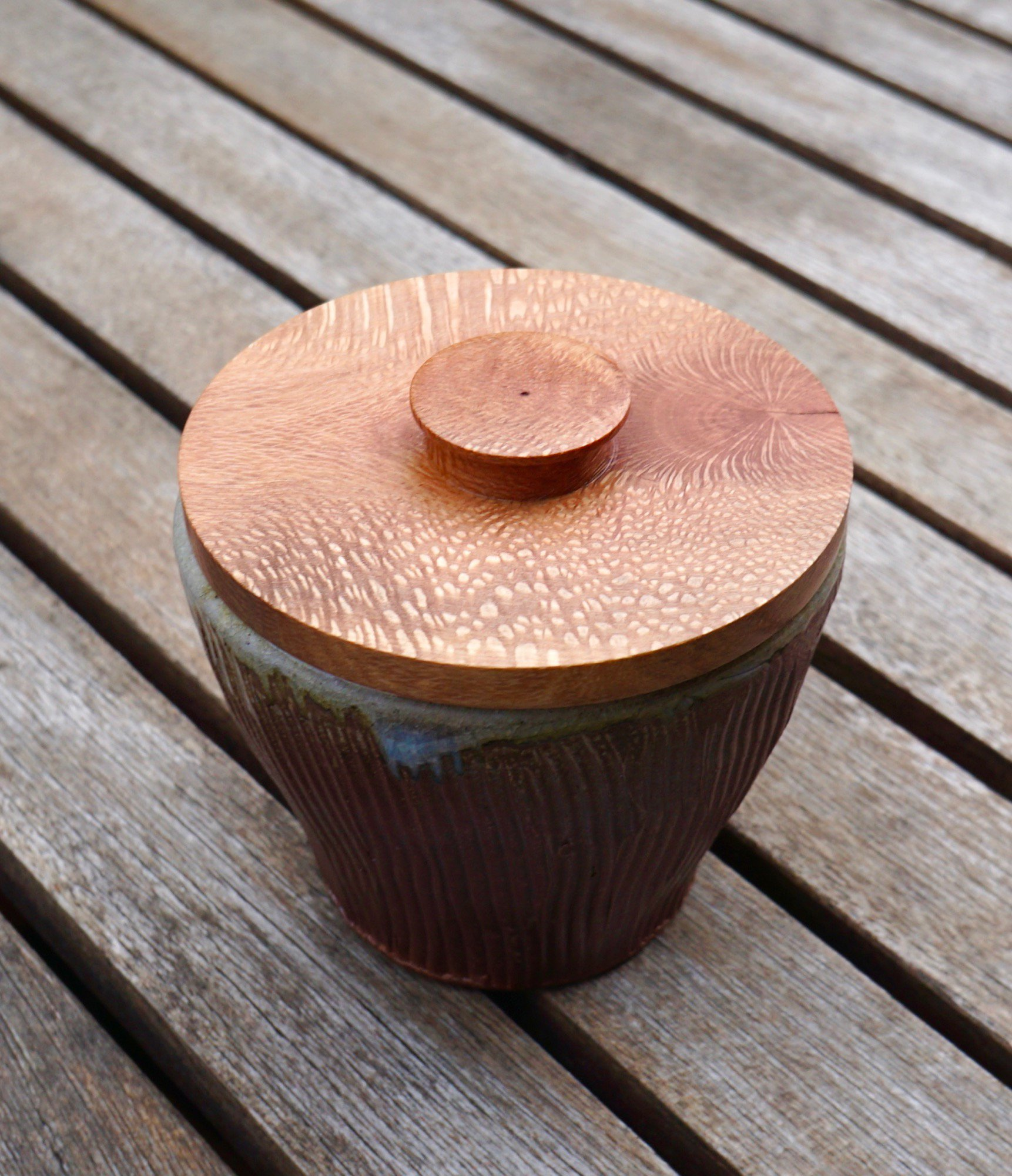 Ceramic bowl with turned macadamia lid